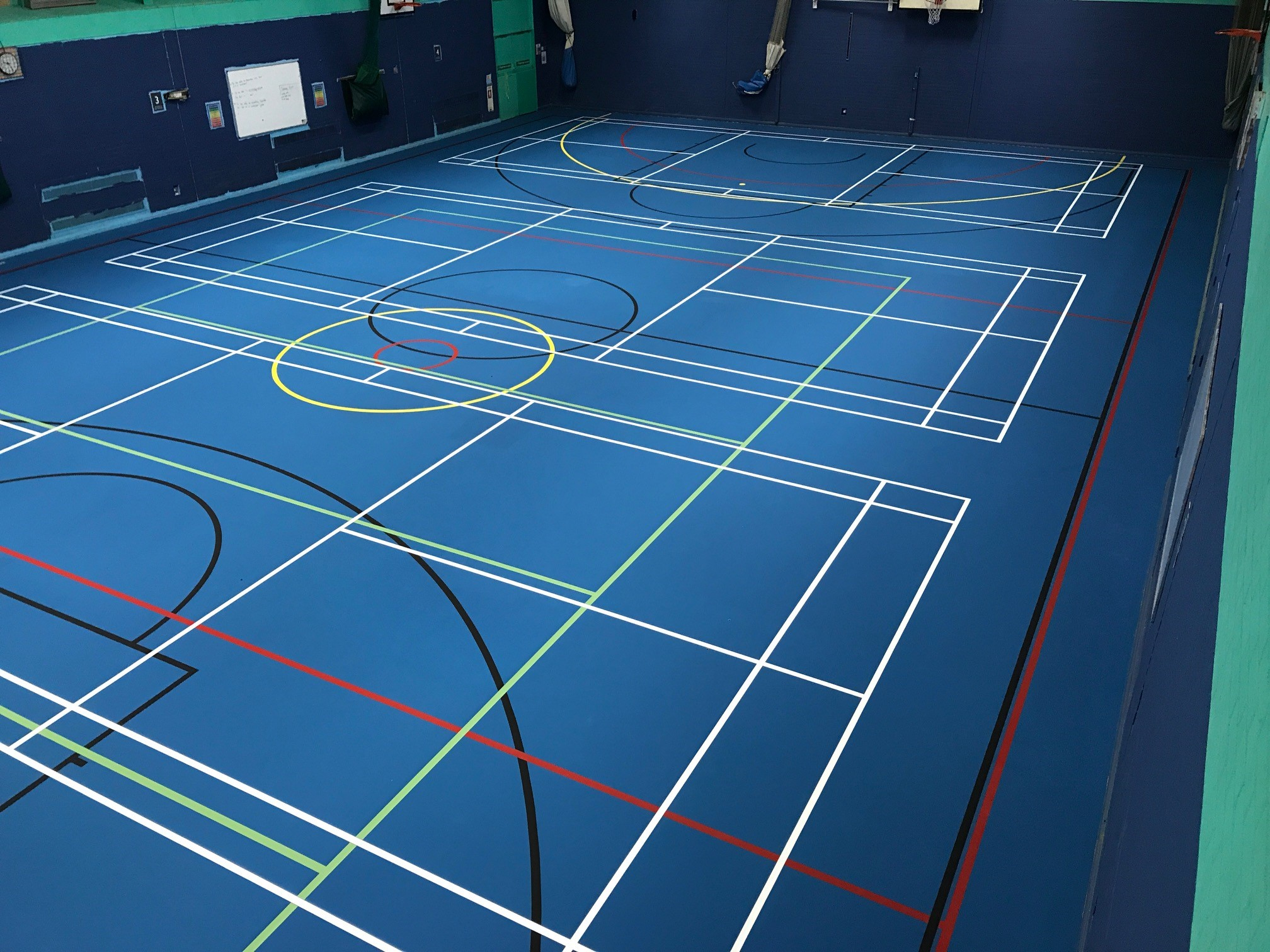 Blue Pulastic sports hall floor installed by Sports Surface UK with court markings