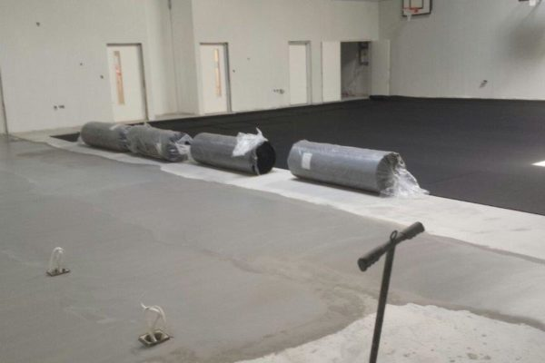Installation school pulastic indoor sports floor by Sports Surfaces UK
