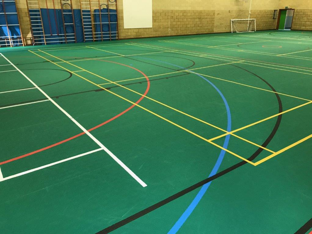 Green Sports hall floor with line markings by Sports Surfaces UK