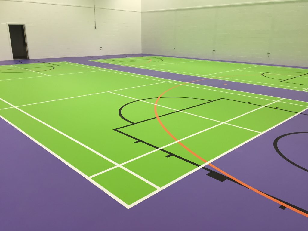 Green and purple pulastic sports hall floor with court markings by Sports Surfaces UK