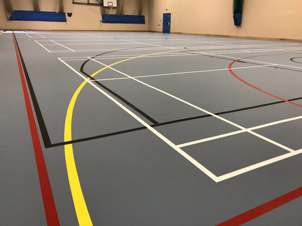indoor school multi-use pulastic sports floor installation with court markings by Sports Surfaces UK