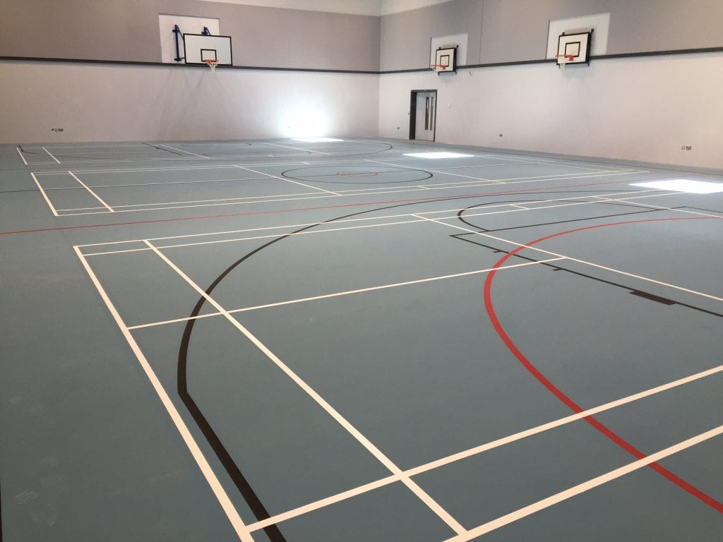 blue pulastic school sports hall floor with court markings by Sports Surfaces UK