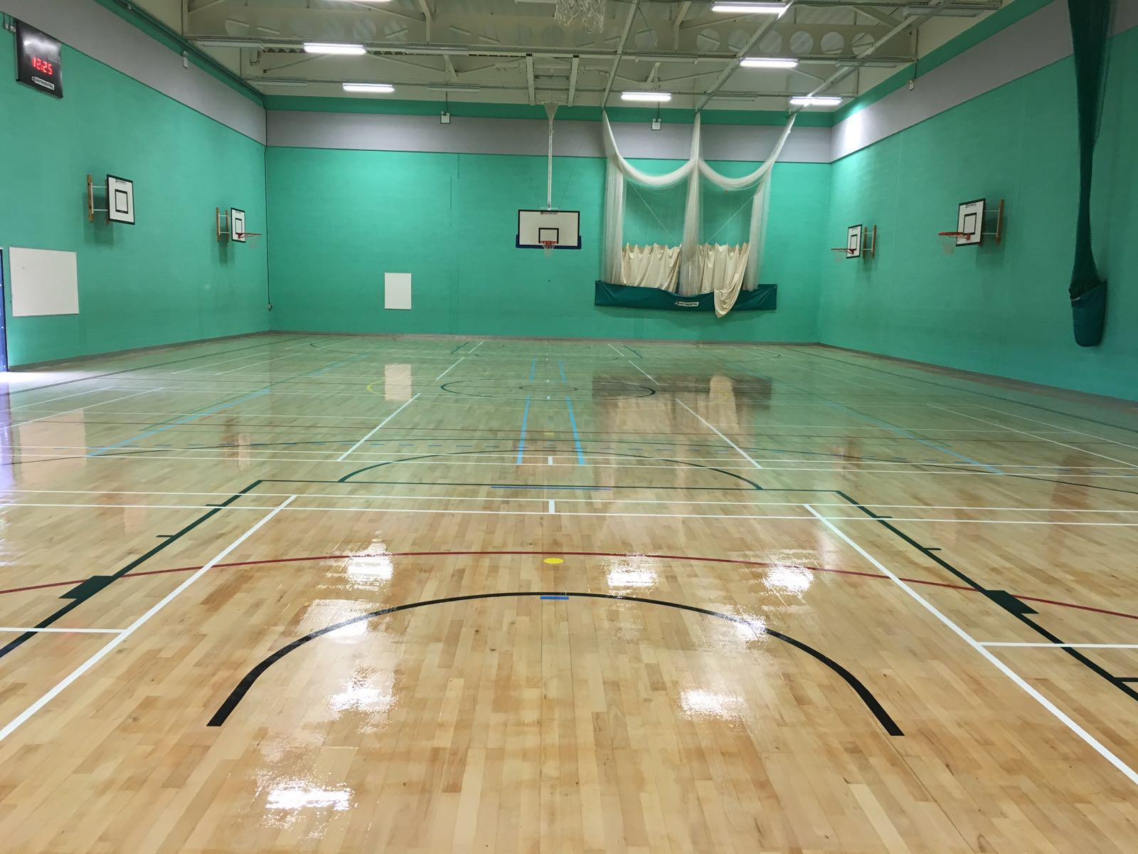 School Timber sports hall court refurbishment with court markings by Sports Surfaces UK