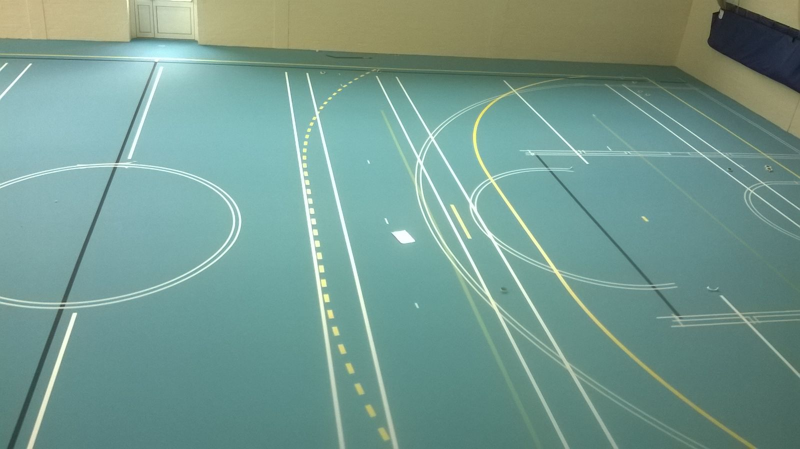 Installation of Pulastic Sports hall floor with court markings by Sports Surfaces UK