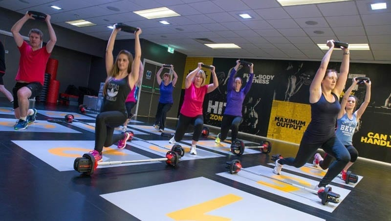 Fitness class using Indoor Vinyl sports flooring by Sports Surfaces UK