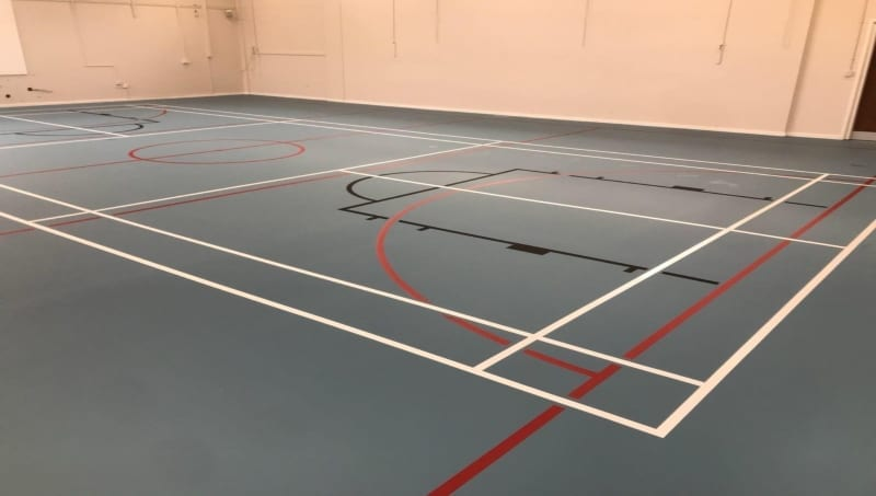New school floor badminton and netball court made with pulastic