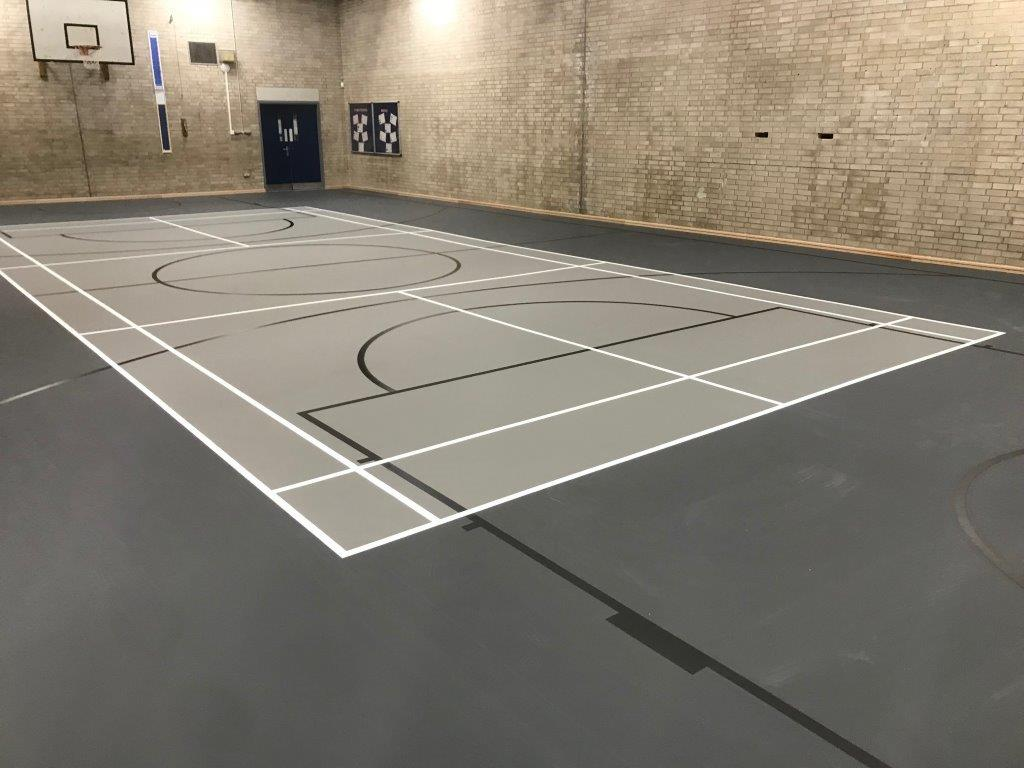 Line markings on Grey Pulastic Sports hall floor by Sports Surfaces UK
