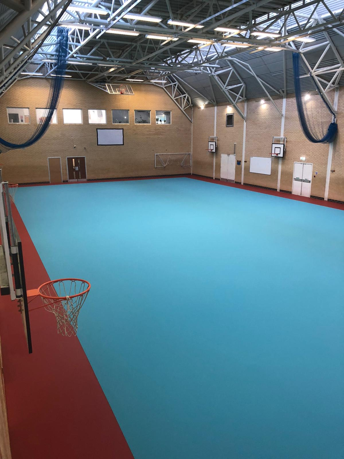 Pulastic indoor sports floor Blue 594 sqm 305 with Red Oxide Perimeter to Netball Court
